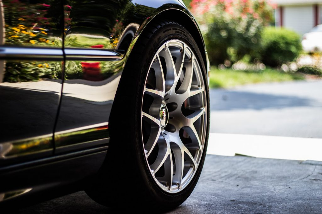 closeup of a car tire, VMR wheels, car parked in home garage