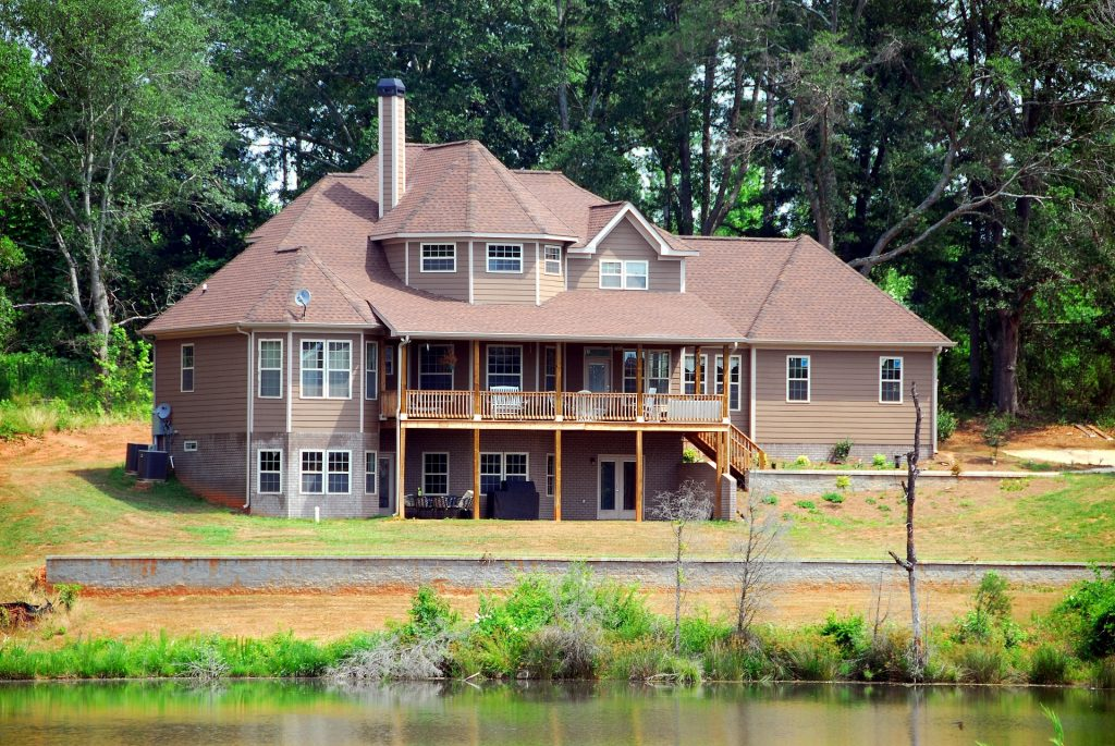 house on the water, vinyl siding, brick siding, two-story house with second level porch